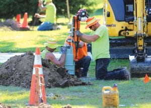Crews work on installing fiber-optic cable on Parrott Street last Friday, as part of AVS' village-wide project in Deckerville. Photo by Sharon Rich