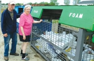 Pandemic or no pandemic, Jim and Nan Bradley regularly make the trip from their home in Deckerville to deposit recyclables in these outdoor receptacles at the Sanilac Recycling Center in Sandusky. Photo by Steven Kovac